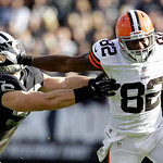 Cleveland Browns tight end Benjamin Watson (82) runs past Oakland Raiders linebacker Miles Burris (56) during the first quarter of an NFL football game in Oakland, Calif., Sunday, Dec. 2, 20 …