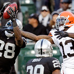 Oakland Raiders defensive back Phillip Adams (28) intercepts a pass intended for Cleveland Browns wide receiver Josh Gordon (13) during the second quarter of an NFL football game in Oakland, …