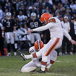 Cleveland Browns kicker Phil Dawson (4) kicks a 35-yard field goal from the hold of punter Reggie Hodges during the third quarter of an NFL football game against the Oakland Raiders in Oakla …