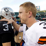 Cleveland Browns quarterback Brandon Weeden, right, greets Oakland Raiders quarterback Carson Palmer after an NFL football game in Oakland, Calif., Sunday, Dec. 2, 2012. The Browns won 20-17 …