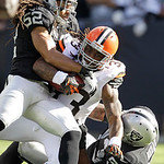 Oakland Raiders linebacker Philip Wheeler (52) and defensive tackle Tommy Kelly (93) tackled Cleveland Browns running back Trent Richardson (33) during the first quarter of an NFL football g …