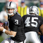 Oakland Raiders quarterback Carson Palmer (3) drops back to pass against the Cleveland Browns during the first quarter of an NFL football game in Oakland, Calif., Sunday, Dec. 2, 2012. (AP P …