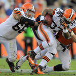Cleveland Browns running back Trent Richardson (33) is tackled by Denver Broncos middle linebacker Keith Brooking (57) as guard Cleveland Browns Shawn Lauvao (66) tries to block in the fourt &#8230;
