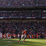 Denver Broncos wide receiver Eric Decker (87), center, runs down the field as Cleveland Browns cornerback Joe Haden (23) defends on a pass play during the second quarter of an NFL football g …