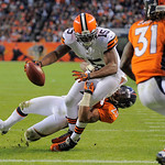 Cleveland Browns wide receiver Greg Little (15) reaches across the goal line with the ball for a touchdown as Denver Broncos cornerback Chris Harris (25) pulls him down in the fourth quarter …