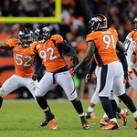 Denver Broncos Wesley Woodyard (52) and Elvis Dumervil (92) celebrate after a sack on Cleveland Browns quarterback Colt McCoy during the fourth quarter of an NFL football game, Sunday, Dec.  &#8230;