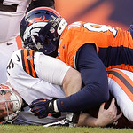 Cleveland Browns quarterback Brandon Weeden (3) is sacked by Denver Broncos defensive end Elvis Dumervil (92) in the third quarter of an NFL football game, Sunday, Dec. 23, 2012, in Denver. …