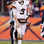 Cleveland Browns quarterback Brandon Weeden grimaces in pain after being sacked by the Denver Broncos during the third quarter of an NFL football game, Sunday, Dec. 23, 2012, in Denver. (AP …