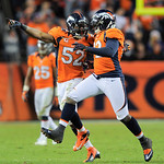 Denver Broncos outside linebacker Wesley Woodyard (52) congratulates defensive end Elvis Dumervil (92) after Dumervil sacked Cleveland Browns quarterback Colt McCoy (12) in the fourth quarte &#8230;