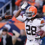 Cleveland Browns free safety Usama Young (28) is congratulated after intercepting a pass by Dener Broncos quarterback Peyton Manning in the end zone  during the second quarter of an NFL foot …