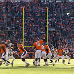 Denver Broncos quarterback Peyton Manning (18) throws a pass during an NFL football game against the Cleveland Browns, Sunday, Dec. 23, 2012, in Denver. Manning led the Broncos to a 34-12 wi …