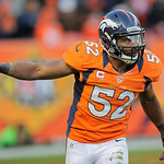 Denver Broncos outside linebacker Wesley Woodyard (52) reacts after a defensive play against the Cleveland Browns in the fourth quarter of an NFL football game, Sunday, Dec. 23, 2012, in Den …
