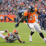 Denver Broncos running back Knowshon Moreno (27) slips away from Cleveland Browns cornerback Buster Skrine (22) in the fourth quarter of an NFL football game, Sunday, Dec. 23, 2012, in Denve &#8230;
