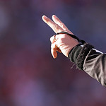 A umpire signals 2nd down during  an NFL football game between the Denver Broncos and the Cleveland Browns, Sunday, Dec. 23, 2012, in Denver. (AP Photo/Joe Mahoney)