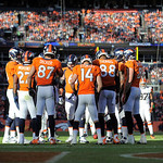 The Denver Broncos offense huddles during  of an NFL football game against the Cleveland Browns, Sunday, Dec. 23, 2012, in Denver. (AP Photo/Jack Dempsey)
