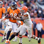 Cleveland Browns defensive end Jabaal Sheard, right, tries to take the ball away from Denver Broncos wide receiver Demaryius Thomas (88) during an NFL football game, Sunday, Dec. 23, 2012, i …