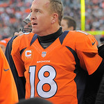 Denver Broncos quarterback Peyton Manning watches the final minutes of the Broncos 34-12 win against the Cleveland Browns from the bench area of an NFL football game, Sunday, Dec. 23, 2012,  …