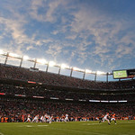 Sports Authority Field at Mile High is illuminated by the lights at the stadium as the Denver Broncos play the Cleveland Browns in the fourth quarter of a NFL football game, Sunday, Dec. 23, &#8230;