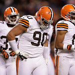Cleveland Browns cornerback Johnson Bademosi (37) and defensive tackle Billy Winn (90) walk back to the line of scrimmage in the fourth quarter of an NFL football game against the Denver Bro …