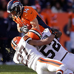 Denver Broncos wide receiver Brandon Stokley (14) is tackled by Cleveland Browns free safety Eric Hagg (27) and middle linebacker D&#039;Qwell Jackson (52) in the first quarter of an NFL football &#8230;
