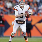 Cleveland Browns quarterback Brandon Weeden rolls out of the pocket with the football against the Denver Broncos in the fourth quarter of an NFL football game, Sunday, Dec. 23, 2012, in Denv &#8230;