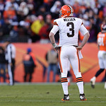 Cleveland Browns quarterback Brandon Weeden stands with his hands on his hips during the second quarter of an NFL football game against the Denver Broncos, Sunday, Dec. 23, 2012, in Denver. …