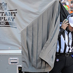 Referee Al Riverson steps out of the instant replay tent during the second quarter of an NFL football game between the Denver Broncos and the Cleveland Browns, Sunday, Dec. 23, 2012, in Denv …