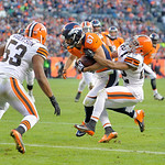 Denver Broncos wide receiver Eric Decker (87) pushes his way to the end zone for a touchdown against Cleveland Browns cornerback Buster Skrine (22) and linebacker Craig Robertson (53) in the …