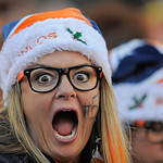 A Denver Broncos fan cheers during an NFL football game between the Denver Broncos and the Cleveland Browns, Sunday, Dec. 23, 2012, in Denver. (AP Photo/Jack Dempsey)