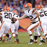 Cleveland Browns quarterback Colt McCoy (12) hands the ball off to running back Montario Hardesty (20) during the fourth quarter of an NFL football game, against the Denver Broncos, Sunday,  …