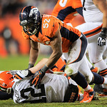 Denver Broncos outside linebacker Wesley Woodyard (52) pushes off of Cleveland Browns quarterback Colt McCoy (12) after sacking him in the fourth quarter of an NFL football game, Sunday, Dec …