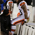 Cleveland Browns running back Trent Richardson (33) has his ankle checked on the sidelines late in  an NFL football game against the Denver Broncos, Sunday, Dec. 23, 2012, in Denver. (AP Pho …