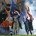 Ann Judge-Wegener rides Thunder onto the field before  of an NFL football game between the Denver Broncos and the Cleveland Browns, Sunday, Dec. 23, 2012, in Denver. (AP Photo/Julie Jacobson …