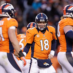 Denver Broncos quarterback Peyton Manning (18) talks to teammates during the Broncos 34-12 win over the Cleveland Browns in a NFL football game, Sunday, Dec. 23, 2012, in Denver. (AP Photo/J …