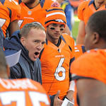 Denver Broncos quarterback Peyton Manning, wears a jacket, as he talks to teammates on the bench during an NFL football game against the Cleveland Browns, Sunday, Dec. 23, 2012, in Denver. ( …