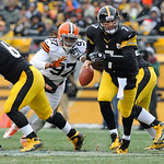 Cleveland Browns defensive end Jabaal Sheard (97) rushes as Pittsburgh Steelers quarterback Ben Roethlisberger (7) looks to hand off in the first quarter of an NFL football game on Sunday, D …