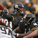 Pittsburgh Steelers quarterback Ben Roethlisberger (7) passes as his line protects him as Cleveland Browns defensive end Jabaal Sheard (97) rushes in the second quarter of an NFL football ga …