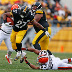 Pittsburgh Steelers running back Jonathan Dwyer (27) runs out of the grasp of Cleveland Browns linebacker Craig Robertson (53) up the middle for an eight-yard gain during the first quarter o …