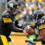 Pittsburgh Steelers quarterback Ben Roethlisberger (7) hands the ball off to running back Jonathan Dwyer (27) during the third quarter of an NFL football game against the Cleveland Browns on …