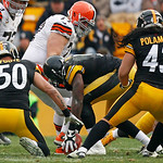 Pittsburgh Steelers inside linebacker Lawrence Timmons, center, recovers a fumble by Cleveland Browns wide receiver Josh Gordon (13) during the second quarter of an NFL football game in Pitt …