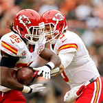 Kansas City Chiefs running back Jamaal Charles (25) takes the handoff from quarterback Brady Quinn on his wat to an 80-yard touchdown run against the Cleveland Browns in the first quarter of …