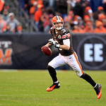 Cleveland Browns quarterback Brandon Weeden runs away from pressure in the third quarter of an NFL football game Sunday, Dec. 9, 2012, in Cleveland. (AP Photo/Tony Dejak)