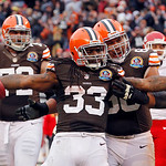 Cleveland Browns running back Trent Richardson (33) celebrates his 1-yard touchdown run with guard Shawn Lauvao in the third quarter of an NFL football game against the Kansas City Chiefs Su …