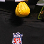 A flag rests on a belt of an NFL official during an NFL football game between the Cleveland Browns and the Kansas City Chiefs Sunday, Dec. 9, 2012, in Cleveland. (AP Photo/Tony Dejak)
