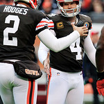 Cleveland Browns place kicker Phil Dawson (4) is congratulated by holder Reggie Hodges after a 23-yard field goal against the Kansas City Chiefs in the first quarter of an NFL football game, …