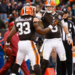 Cleveland Browns running back Trent Richardson (33) receives congratulations from quarterback Brandon Weeden (3) after scoring a touchdown against the Kansas City Chiefs during an NFL footba …