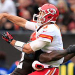 Kansas City Chiefs quarterback Brady Quinn is hit by Cleveland Browns linebacker D'Qwell Jackson as he throws in the first quarter of an NFL football game Sunday, Dec. 9, 2012, in Cleveland. …