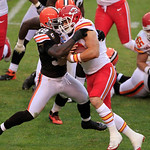 Cleveland Browns linebacker D'Qwell Jackson, left, tackles Kansas City Chiefs running back Peyton Hillis during an NFL football game Sunday, Dec. 9, 2012, in Cleveland. (AP Photo/Tony Dejak)