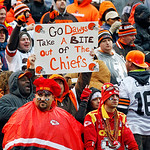 Cleveland Browns fans cheer behind two Kansas City Chiefs fans at the start of the fourth quarter of an NFL football game, Sunday, Dec. 9, 2012, in Cleveland. (AP Photo/Tony Dejak)