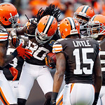 Cleveland Browns wide receiver Travis Benjamin (80) is congratulated by teammates after a 93-yard punt return for a touchdown in the second quarter of an NFL football game against the Kansas …